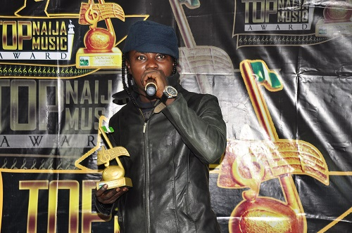 Osh Michael with his Best R n B Act of The Year 2014 Award