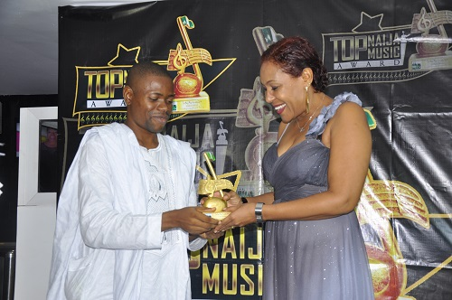 TopNaijaMusic. CEO, Paul Oghoghorie, presenting Milestone Achievement Award to Actress, Shan George
